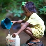 Khmu kid gets water from a stream near the Mekong.Luang Prabang Province, Laos