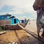 Unloading river freighters from Vietnam. Phnom Penh, Cambodia