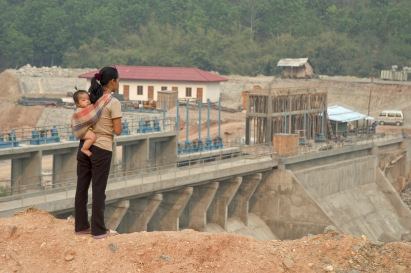 Dam construction places additional burdens on the lives of women.Photo Credit: Marcus Rhinelander