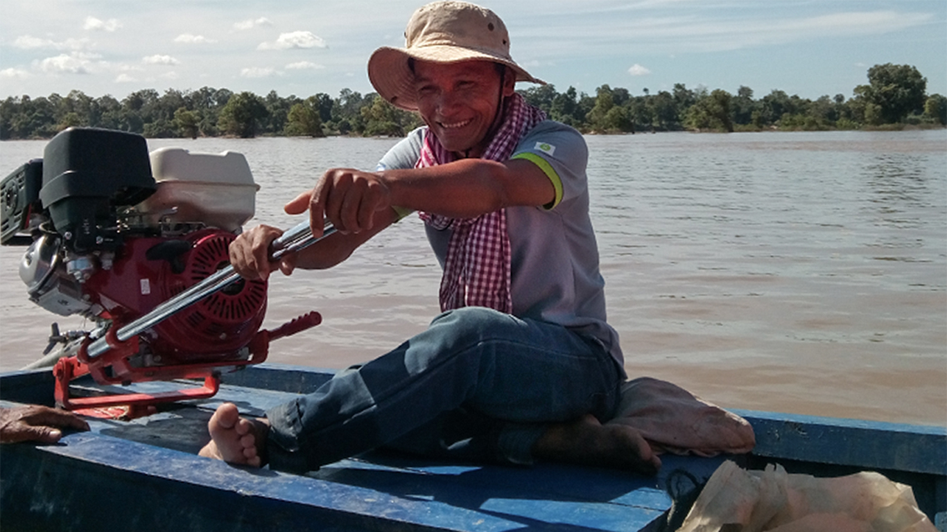 An Hou is on the patrolling boat at Kandol Mouy Roy Deep Pool conservation zone of the Mekong River in Sambo district of Kratie province, photo by Socheata Sim/Oxfam
