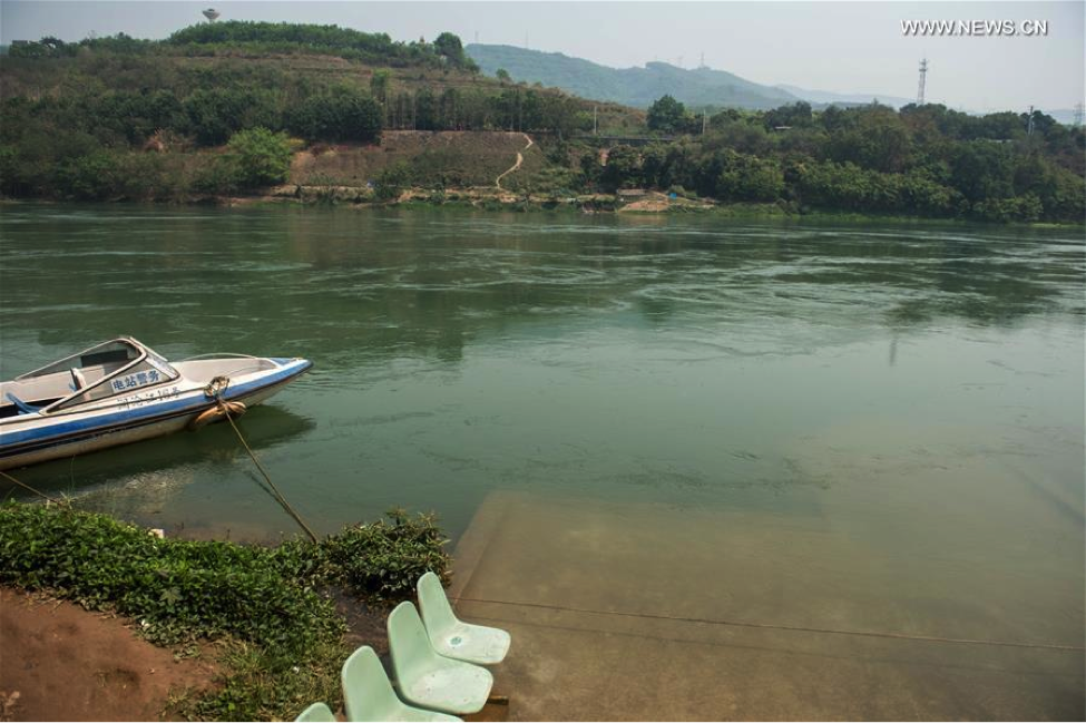 Stairs and vegetable fields are partially submerged at the lower reaches of Lancang River in southwest China's Yunnan Province, March 20, 2016. (Photo source: NEWS.CN)